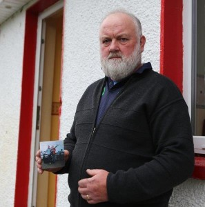 Patrick McLaughlin holds a picture of his youngest son Enda at his home in Glentogher. Pic Copyright Northwest Newspix