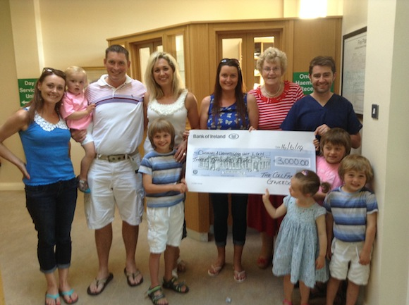 The Coll family present the cheque to the Oncology Unit at LGH.