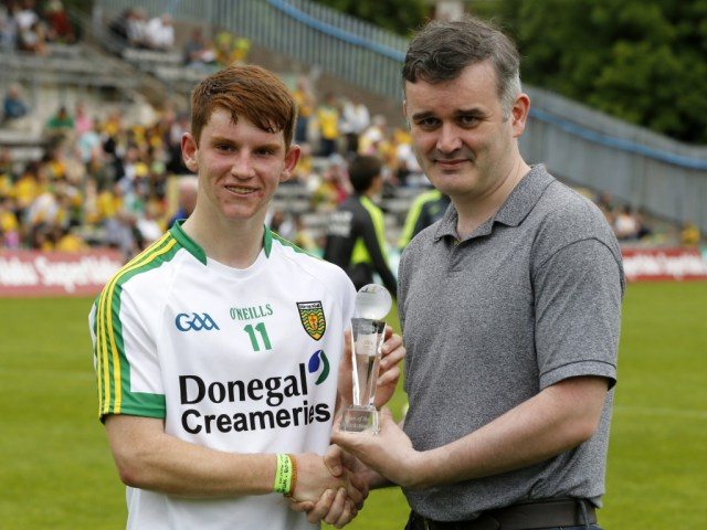 Lorcan O'Connor received his award from Patrick McCarney, Customer Relationship Manager, Electric Ireland after his star performance in his team's win over Antrim in the Electric Ireland Ulster Minor Football Championship.