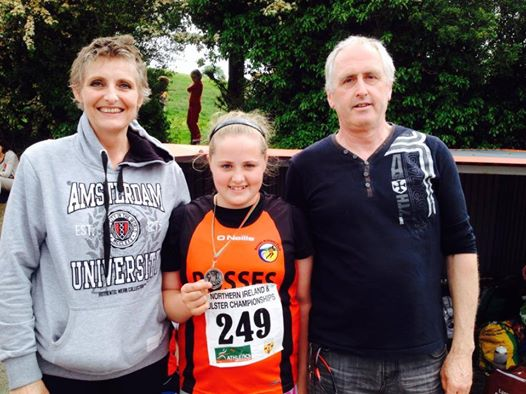 Silver for Emily Croke in the U-11 Shot Putt with proud parents Anne and Tony.