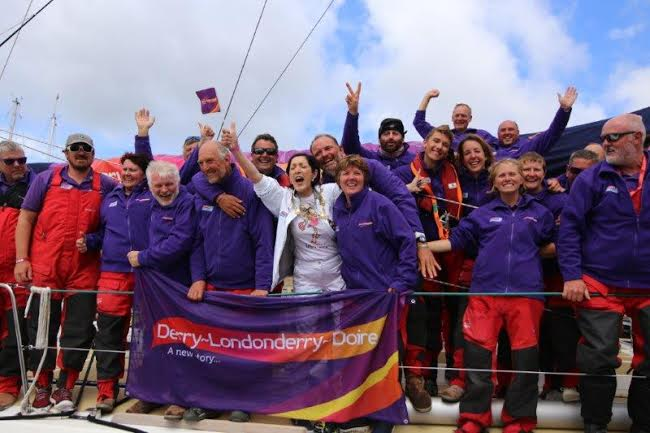 The crew of the Derry Clipper celebrate their homecoming with the city's Mayor Brenda Stevenson.
