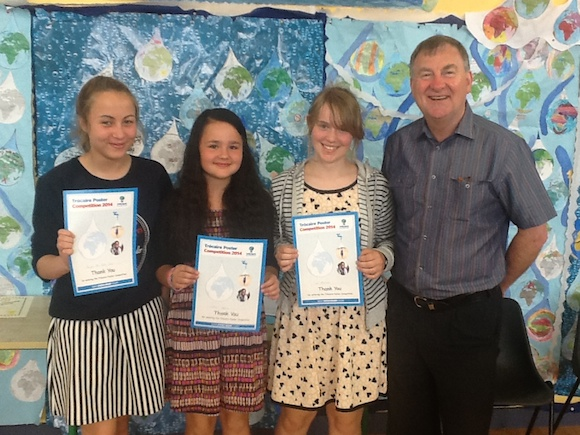 Trocaire national awards for sixth class pupils,Sarah,Vanessa and Wictoria with the principal Tom Feeney