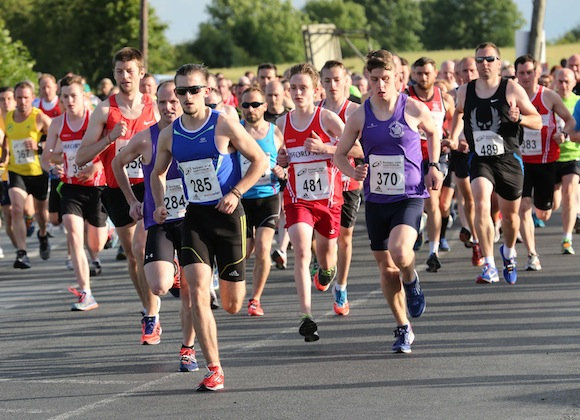 Lead runners hit the road at the start of the St. Johnston 5K Road Race earlier this evening. Pic.: Gary Foy