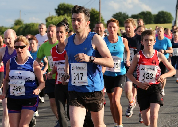 Andrew Leighton (317) leads this group as they set off to tackle the St. Johnston 5K Road Race. Pic.: Gary Foy