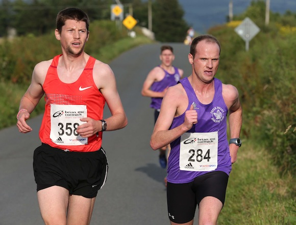 St. Johnston 5K Race winner Adrian Mc Gowan of Foyle Valley AC turns for home with 2nd placed Gary Slevin of City of Derry Spartans on his shoulder and 3rd placed Stephen Connor not too far behind. Pic.: Gary Foy