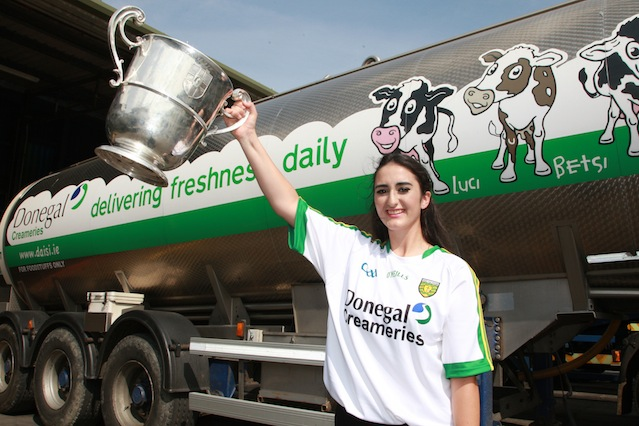 Bridgid Mc Dyre winner of the Donegal's best supporter pictured with Donegal Creameries Headquarters at Crossroads Killygordan with the Anglo Celt Cup. Photo Cristeph/Brian McDaid