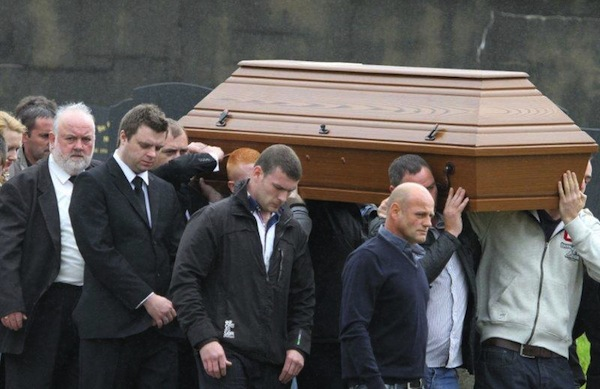 The coffin of the late Enda McLaughlin is brought to its final resting place.