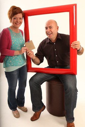 Jacqueline Molloy receives her voucher for a free family portrait from Stephen Maguire, editor of Donegal Daily.