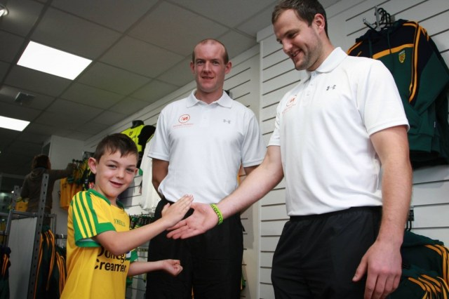 Fellow Glenswilly GAA Club member Shane Tinney (son of Paddy Tinney) tries to deal for the best price with Neil Gallagher and Micheal Murphy when he got a pre- opening tour of the new sport shop in Letterkenny today. Photo Cristeph Brian McDaid