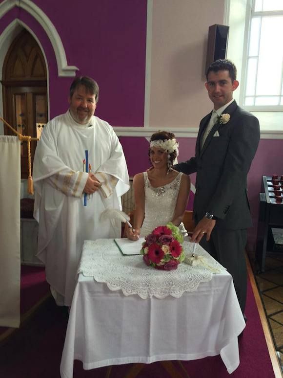 Over the bar...sorry, over the moon. The happy couple with Fr Pat