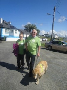 Well known Tory resident Jimmy Doohan with wife Theresa and his loyal guide dog.