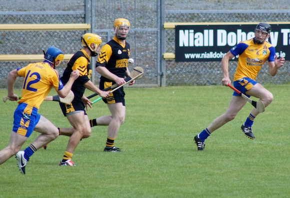 Sean McVeigh breaks through the Burt defence under pressure from Ronan McDermott