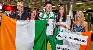 Family and friends greet Bronze medal hero Mark English following his arrival Dublin Airport