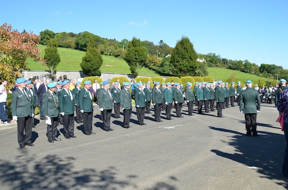 Former members of the Defence Forces stand to attention at Conwal Graveyard. Pics by Geraldine Diver.