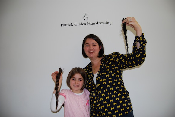 Aoife and Roisin with a new look and their donated hair!