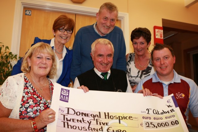 John J Mc Gettigan, Vincent and Brigid O Rourke, present a cheque for Û25,000 proceeds of a cycle in memory on their son Vinnie, they are pictured with Annette Cunningham and Geraldine Casey and Dr James McDaid from the Donegal Hospice . Photo Brian McDaid/ Cristeph