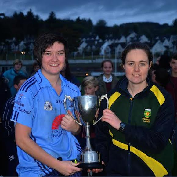 Kathy McLaughlin collects the winning Minor Trophy at O'Donnell Park from Siobhan Coyle, Donegal LGFA Board
