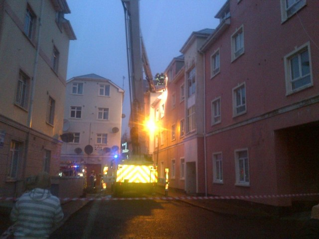 Firemen attempt to take the couple from the apartment. Picture copyright Donegal Daily.