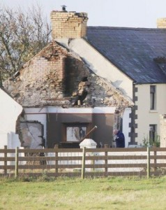 Gardai at the scene of the housefire at Carnmalin yesterday. PIc by Northwest News Pics.