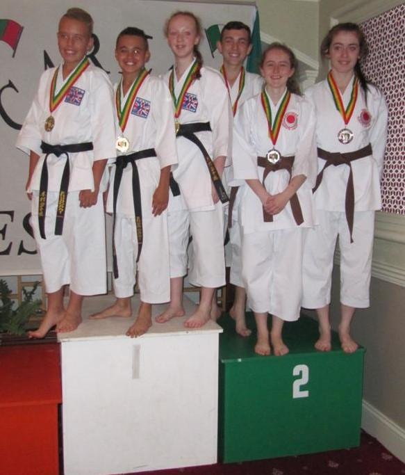 Stephen-John Carlin, Isobel Walsh and Laura Browne with silvers for team kata
