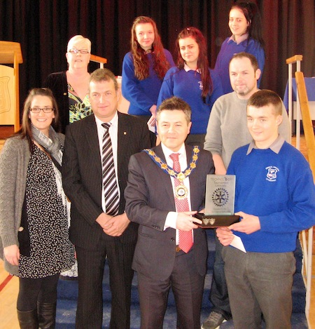 mayor of Limavady Alan Robinson, presenting Niall O' Donnell with the winning trophy. Also included in the photo back row, Mary McCloskey, principal of St Mary's High School, Limavady. Front row, left, teacher Ms McLaughlin and middle row right teacher Mr Sweeney, Errigal College.