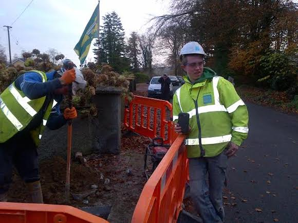 An Irish Water contract worker with his phone videos protestors in Convoy today