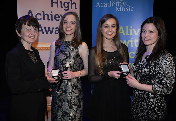 Aoife Walsh (Carndonagh) and Jessica O'Brien (Malin), pictured receiving their High Achiever's Awards from the Royal Irish Academy of Music at the Waterside Theatre, Derry on Sunday last, from Theresa Doyle, Local Centre Manager, Royal Irish Academy of Music (left) and Dr. Jennifer McCay, Chair of Senior Examiners, Royal Irish Academy of Music.