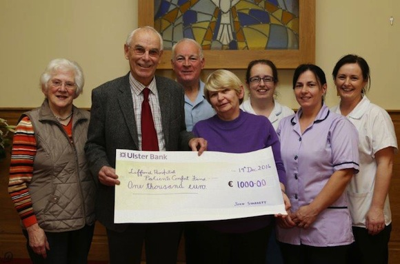 John presents the cheque which were the proceeds form his 80th birthday. Pic by North West Newspix.