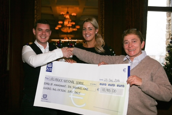 Danny O Carroll (From Mrs Brown's Boys) pictured at the presentation of nearly €10,915 which was raised at his Fundraising Party at the Mt Errigal Hotel. Pictured  Laura Jackson, events manager at the Mt Errigal Hotel. and Ann Fox School Principal, representing Lurgybrack National School Photo By Brian McDaid
