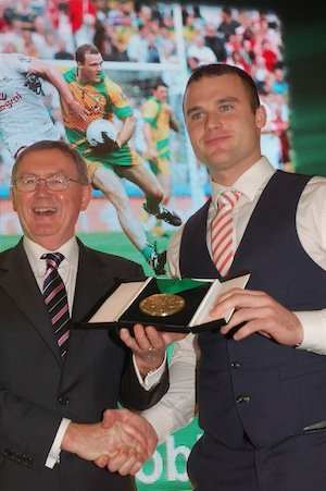 Neil McGee receiving the Donegal Sports Star 'GAA' award from special guest Sean O'Rourke