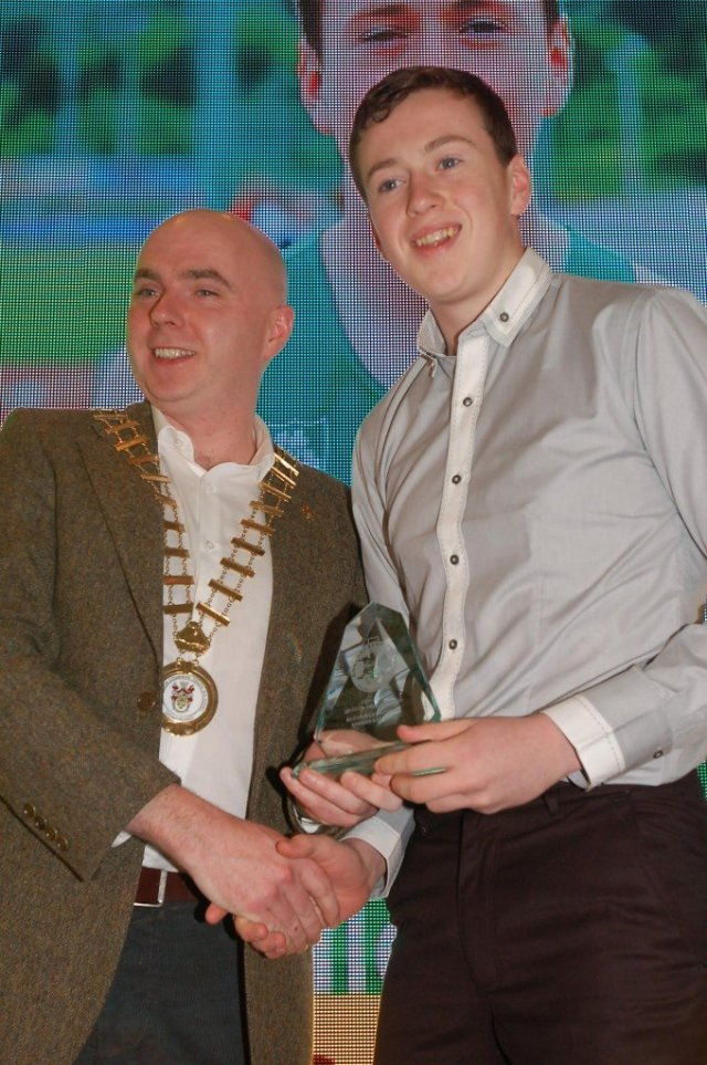 Cathaoirleach of Donegal County Council Cllr John Campbell presents the Best Secondary School Sports Boy award to Brendan O'Donnell (St. Eunan's College)