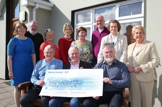 The Donegal Association Dublin present the cheque to members of the hostel.