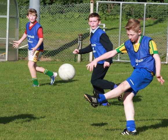 Bobby Bradley on the ball at the  Crana college Gaelic Blitz