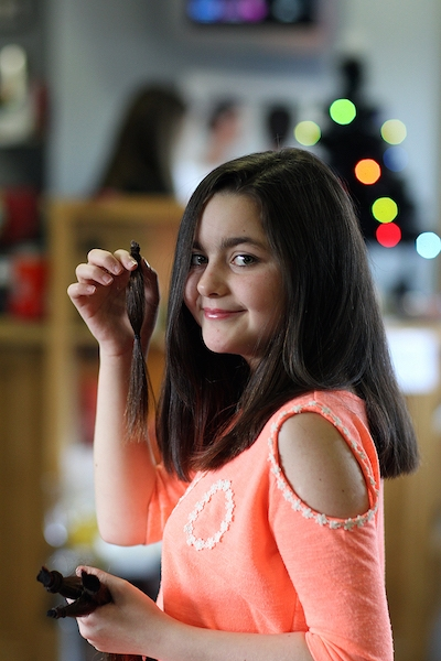 Cancer survivor, Erin Gallagher from Glenswilly, Co Donegal pictured at her local hairdresser, HairDos where she donated her ponytails to The Princess Trust to make wigs for Children With Cancer. Photo Brian McDaid
