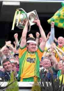 Bloddied but unbowed, Neil Gallagher, Donegal's captain, raises the National League trophy, after Donegal defeated Mayo in the final. Photo Michael O Donnell.
