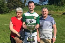 Cockhill Celtic goalscorer Peter Doherty with his parents after the win