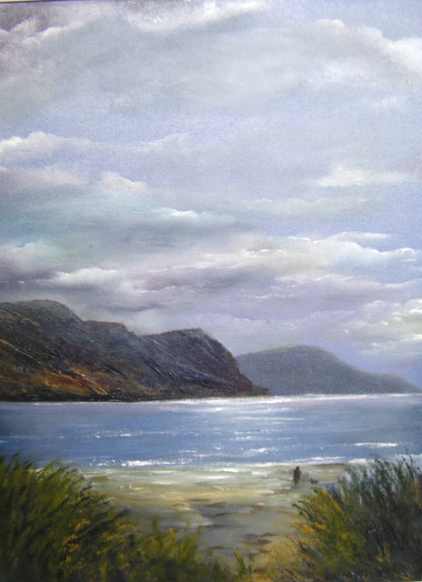 man with dog looking out to sea, west coast of Ireland, Keel Strand, Achill, mountain range