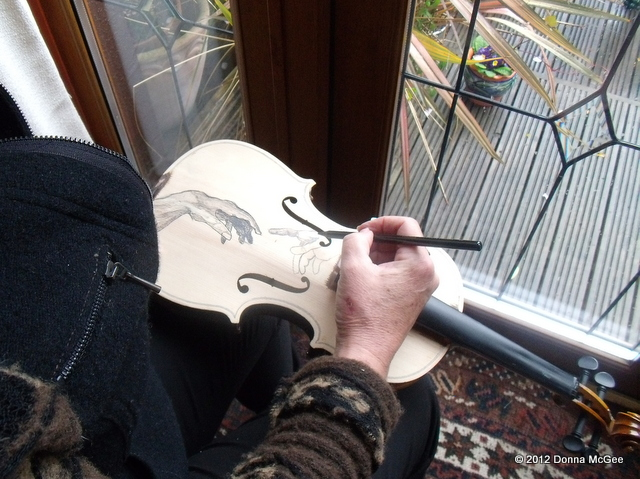 Instrument art on a violin, the creation of adam, pencil sketch