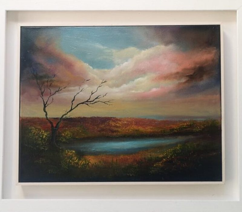Old Bog Road Oil painting in a white frame with colourful sky reflecting on earthy colours in marshy land with a lone bare tree