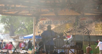 #LakeofStars George Kalukusha singing on the Village Stage on Day 2 of Lake of Stars Festival 2014.