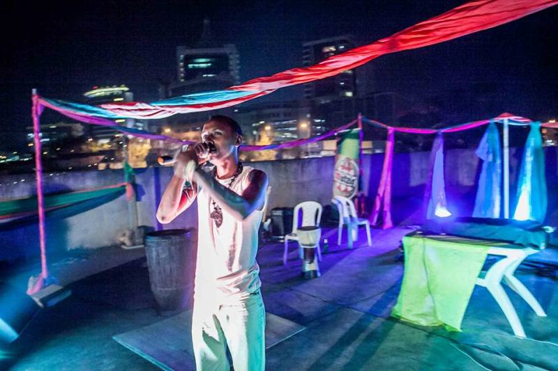 Kigali rapper, Prime, taking the stage at Spring Into Summer. Kigali City Tower
