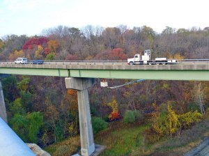 Under Bridge Inspection Unit at work during fall day