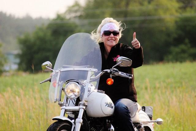 Malinda Johnson riding through Grand Rounds Scenic Byway in Minnesota