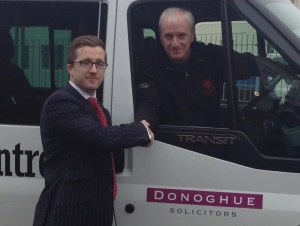 Picture of Kevin Donoghue, Principal Solicitor at Donoghue Solicitors, and Keith Lloyd of local charity Brunswick Youth Club.