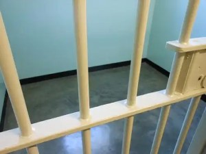 Photo of a prison cell, where people with electronic tagging are wrongfully arrested are held.