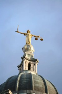 Picture of 'Justice' at the Old Bailey. Donoghue Solicitors helped a client get justice for her apparent police harassment compensation claims.