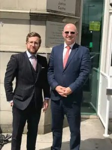 Kevin Donoghue, solicitor, and David Hughes, barrister at Cardiff Civil Justice Centre.