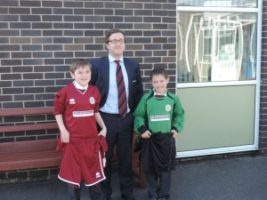 Photo of Kevin Donoghue with pupils of Orrets Meadow School.