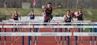 Falmouth Jack Koss takes first the men's 100m hurdles during the Sandwich vs. Falmouth track meet at Sandwich High School Wednesday afternoon.Photo by Don Parkinson