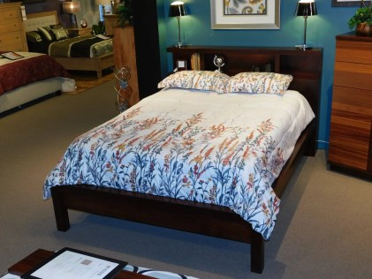 Marquette Bookcase Bed with LED Lights Wood Species Shown: Brown Maple Size Shown: Queen Price As Shown*: $1,543 Fully Customizable *Price of piece is not inclusive of current sales. Please see our Pricing page for more details.
